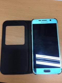 검정케이스 파란색 휴대폰